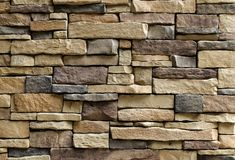 Horizontal Texture of The Asymmetrical Stones Wall Stock Images