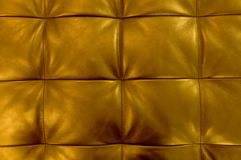 Horizontal Texture of Golden Upholstery Leather Pattern Background. Background Pattern, Closed up of Abstract Texture of Golden Leather Sofa or Upholstery Royalty Free Stock Photo