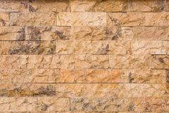 Horizontal Textured Stone Tiled Wall Background. Cream and brown modern stone tiled wall. Great textured wall background for your next project Royalty Free Stock Photography