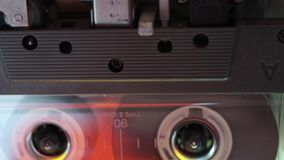 Tracking playing cassette stock video footage