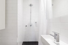 Horizontal verion of white ensuite bathroom in renovated home Stock Photos