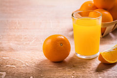 Horizontal version glass with juice and oranges on Stock Photo
