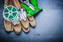 Horizontal version green wire glove fork spade secateurs sprayer Royalty Free Stock Photos
