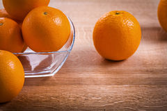 Horizontal version orange fruits in glass square Royalty Free Stock Images