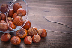 Horizontal version stack of hazelnuts in glass Stock Images