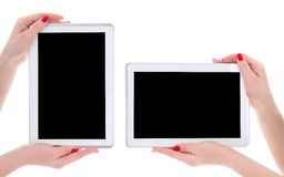 Horizontal and vertical view of modern tablet pc with empty copy. Space screen in female hands isolated on white background Stock Photos