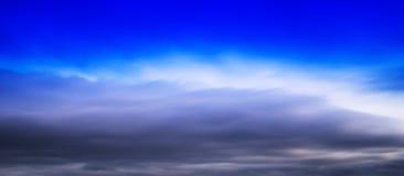 HORIZONTAL VERTICAL VIVID BLUE CLOUDSCAPE DRAMATIC CLOUDS BACKGR Stock Photo