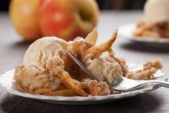 Horizontal view of apple crisp with ice cream. Horizontal view of large dish of apple crisp with vanilla ice cream on top Stock Photography