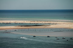 Horizontal view on atlantic ocean with boats by the dune pyla Royalty Free Stock Image