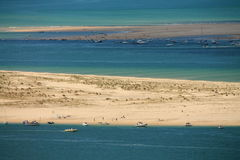 Horizontal view on atlantic ocean with boats by the dune pyla Royalty Free Stock Images