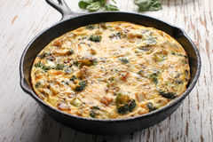 Horizontal view of baked egg frittata with spinach Stock Photo