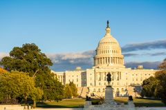 Horizontal View of The Capitol Hill in Washington DC at Golden H. Our before the Sunset on Partially Cloudy Background stock images