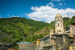 Horizontal View of the Church in the Bay of Vernazza at Summer. stock photography
