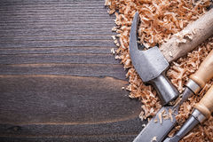 Horizontal view of claw hammer and metal flat Stock Photos