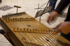 Horizontal View of Close Up of Hands Playing the Salterio Medieval Instrument. Horizontal View of Close Up of Hands Playing the Salterio Medieval Classical royalty free stock images
