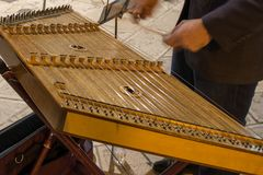 Horizontal View of Close Up of Hands Playing the Salterio Medieval Instrument. Horizontal View of Close Up of Hands Playing the Salterio Medieval Classical royalty free stock photo