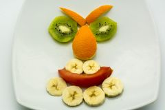 Horizontal View of Close Up some Pieces of Fruit Forming a Face. Expression with Banana, Kiwi, Orange and Tomato stock photography
