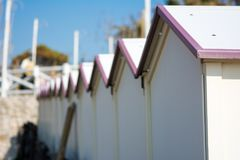 Horizontal View of a Close Up of some Sea Cabins. On Blur Sky Background Royalty Free Stock Photography