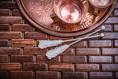 Horizontal view of coppery tray tea cups sugar Stock Image
