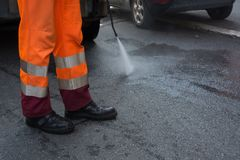 Horizontal View of a Dustman Cleaning the Street With a Water Pr. Essure Machine. Rome, Italy Stock Photography