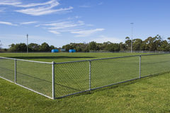 Horizontal view of an empty sports oval. On a sunny day Stock Photography