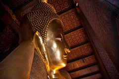 Horizontal view from half of reclining buddha in Wat Pho Royalty Free Stock Photo