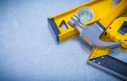 Horizontal view of hammer measuring tape Stock Photography