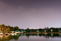 Horizontal view of lake and nature during dusk with night stars and smooth reflection on waters stock photos