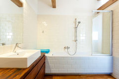 Horizontal view of modern bathroom. Horizontal view of modern and designed bathroom royalty free stock images