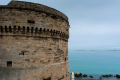 Horizontal View of One of the Stone Towers of The Aragonese Cast. Le on Blue Sea Background. Taranto, South Of Italy Royalty Free Stock Image
