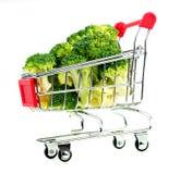 Horizontal view of organic broccoli in miniature shopping cart Stock Photo