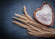 Horizontal view rye ears and piala with flour Royalty Free Stock Image