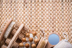 Horizontal view of sauna articles on wicker mat Royalty Free Stock Photos