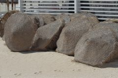 Set of umbrellas in the sand Royalty Free Stock Photos