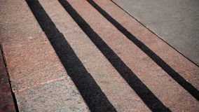 Horizontal view of shadows projected on the granite stairs stock images