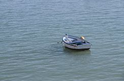 Small boat in the sea Stock Images