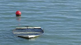 Small boat sunken in the sea Royalty Free Stock Photos