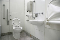 Horizontal view of a toilet interior for disabled Royalty Free Stock Photos