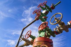 Horizontal view of a wellhead with valve armature. Oil and gas industry concept. Industrial site background. Toned. Horizontal view of a wellhead with valve royalty free stock photos