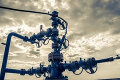 Wellhead with valve armature. Royalty Free Stock Photography