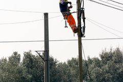 Horizontal View of a Worker Repairing a Light Pole With Safety T Stock Photos