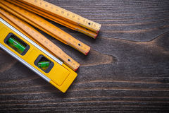 Horizontal view of yellow construction level with wooden meter o Stock Images