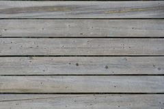Horizontal vintage gray boards with traces of bark beetles as background.  stock images