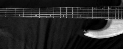 Horizontal vintage 5-string bass guitar Black and White Royalty Free Stock Images