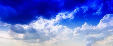 Horizontal vivid blue cloudscape dramatic clouds Stock Photos