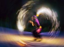 Horizontal vivid fire fakir rotating motion blur abstraction Stock Photo