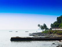 Horizontal vivid Indian beach quay with birds landscape backgrou Royalty Free Stock Photography