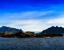 Horizontal vivid Norway fjord mountains in ocean Stock Images