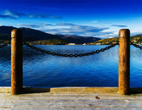 Horizontal vivid Norway pier in front of sea and mountains stock photo