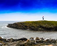 Horizontal vivid Norway right aligned lighthouse  on island land. Scape background backdrop vibrant bright color composition design concept element object shape royalty free stock images